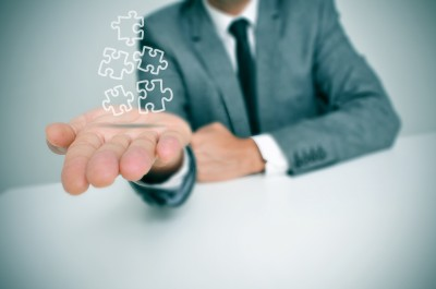 businessman with jigsaw puzzle pieces